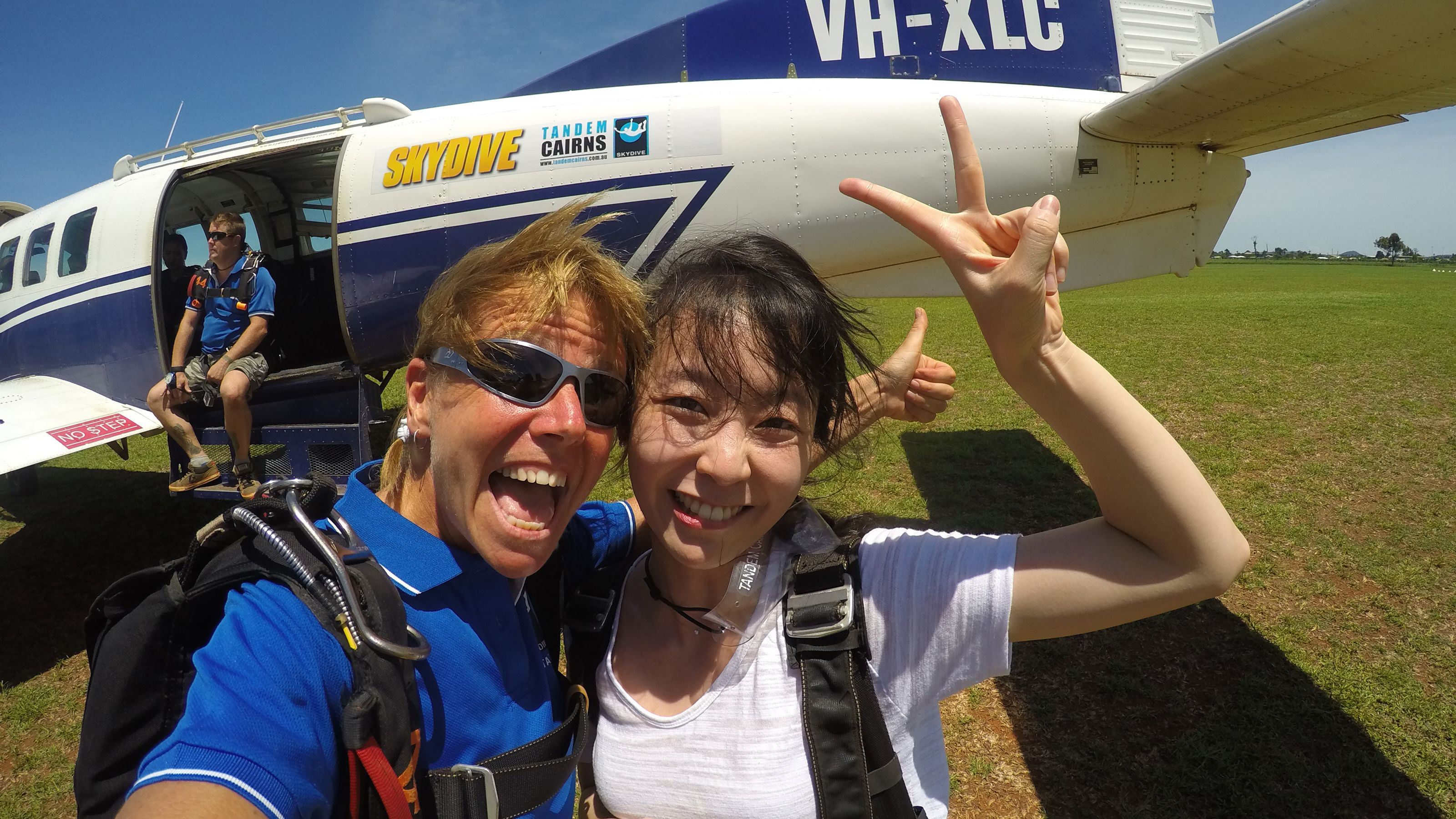 Girls in front of plane for the Tandem Skydive in Cairns Australia