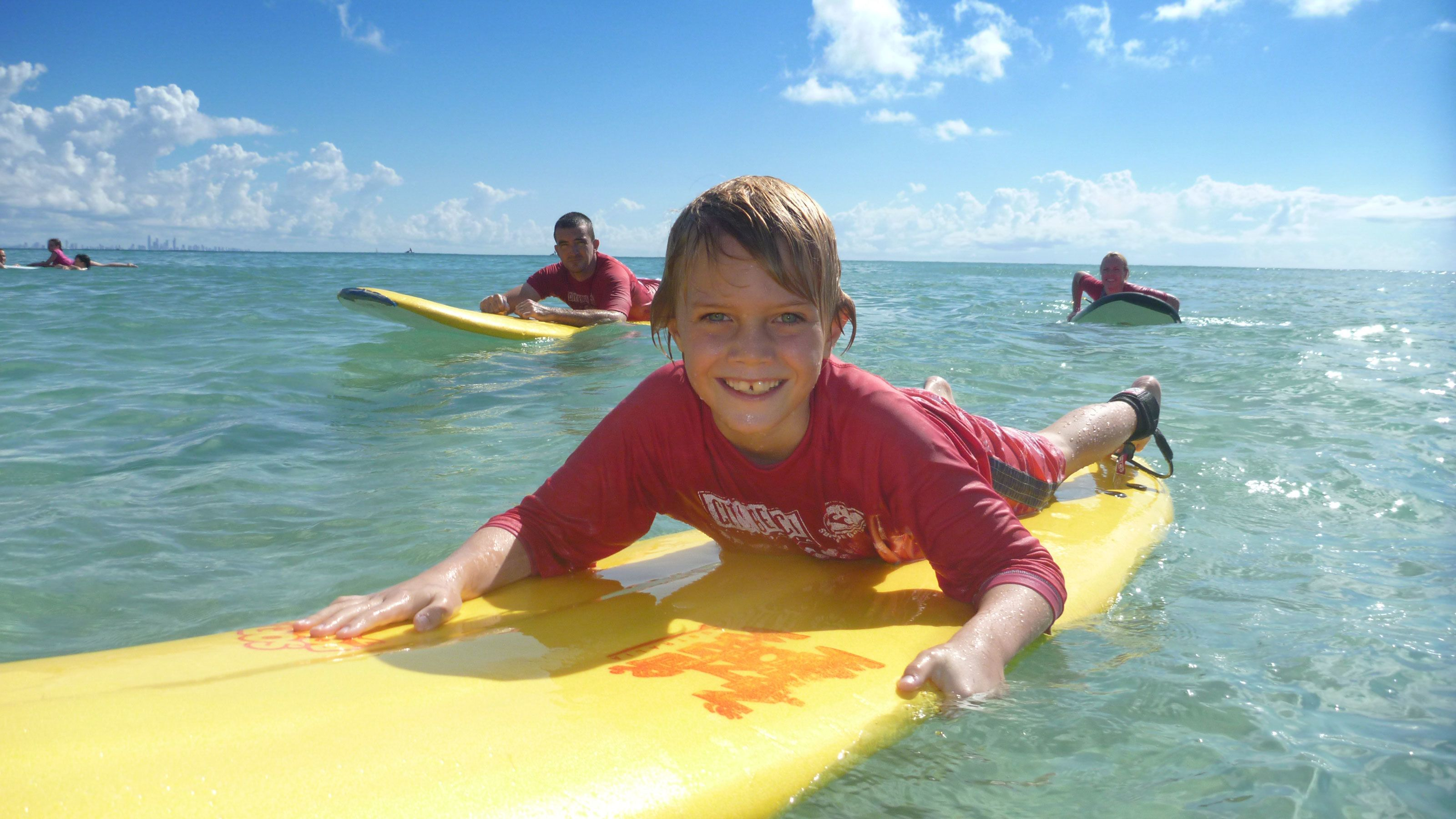 young boy learning to surf in Gold Coast