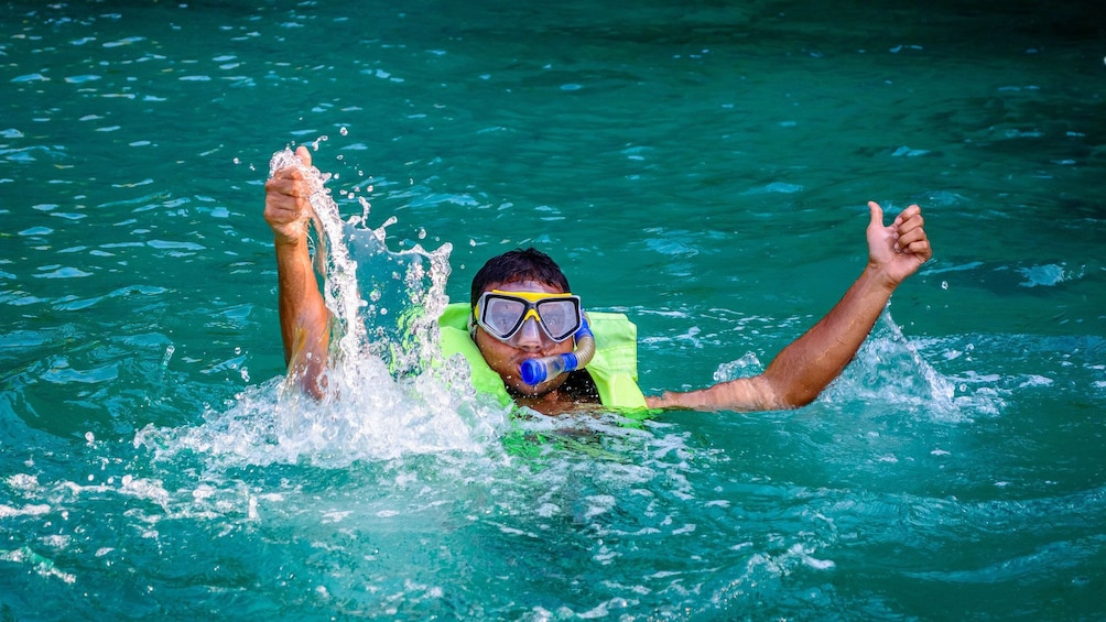 Young man snorkeling in Malgrats Island