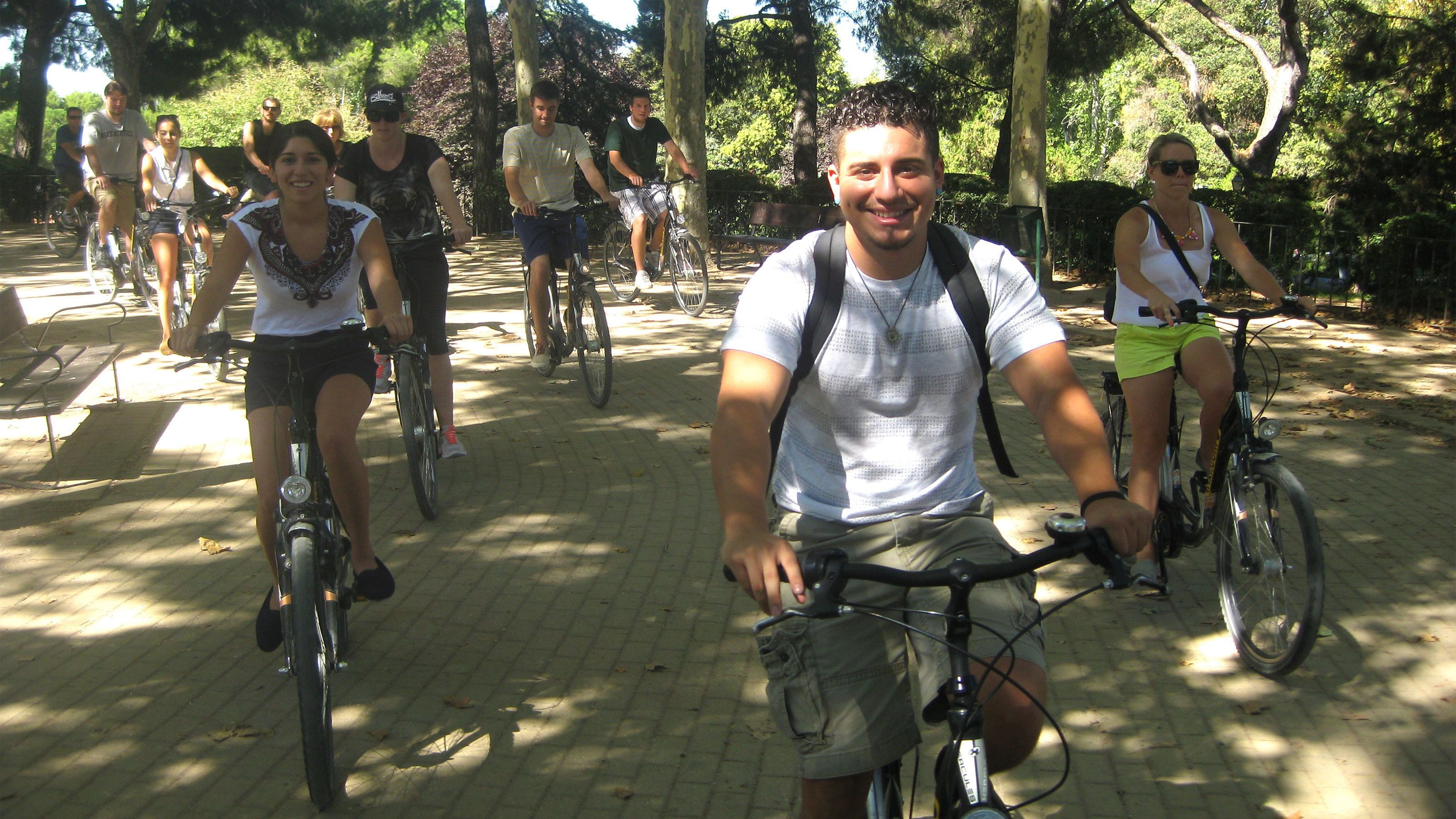 Bicycle tour group riding through park in Madrid