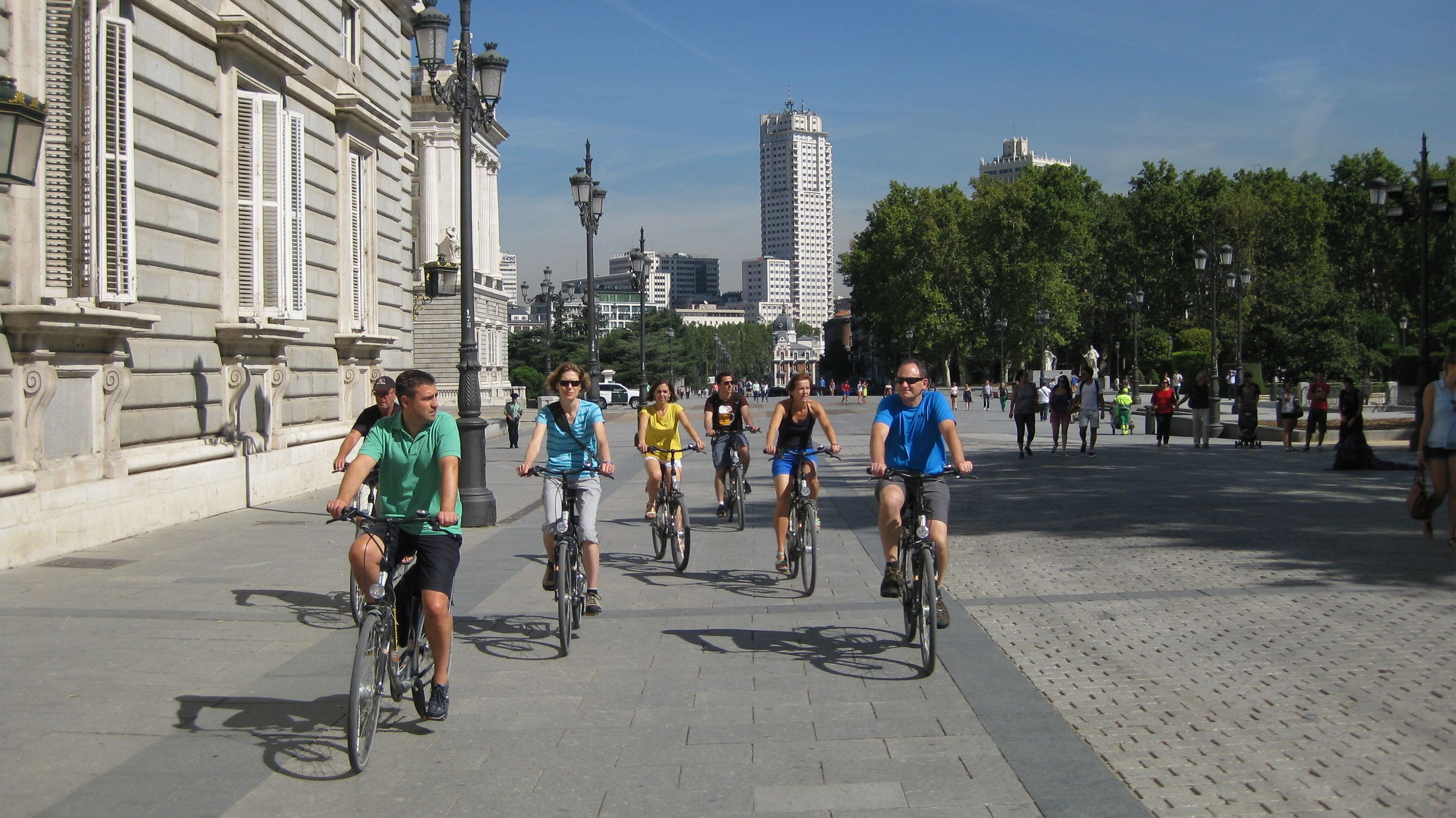 A group bicycling tour on the city streets of Madrid