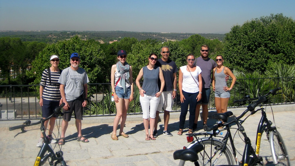 Apri foto 3 di 7. Bicycling group takes a break for a picture in Madrid