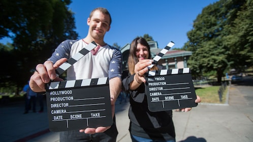 Tour group guests with a pair of film clapboards in Boston