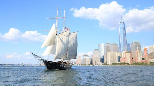 Sailboat with city in the background in New York