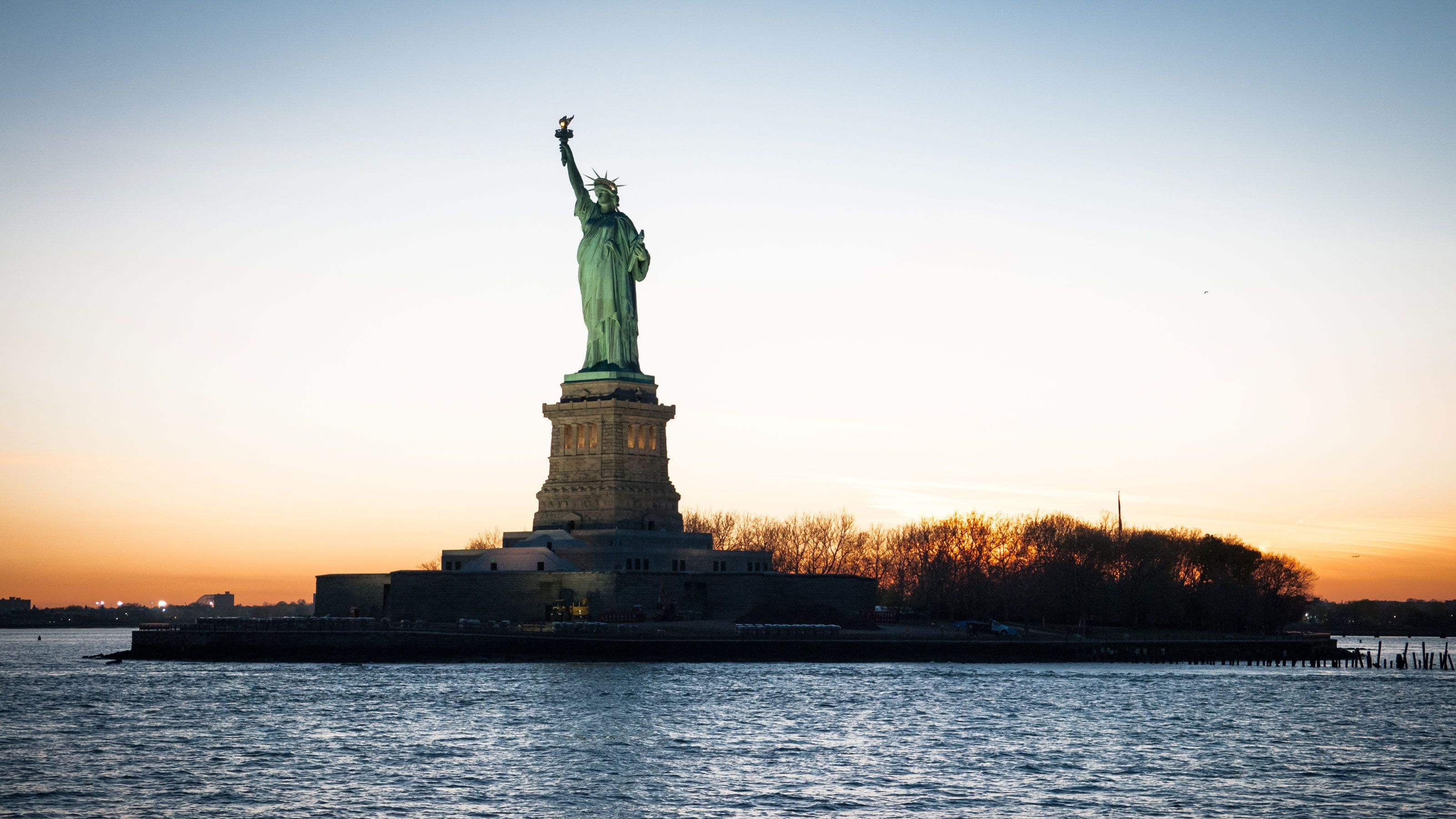 The Statue of Liberty at dusk in New York