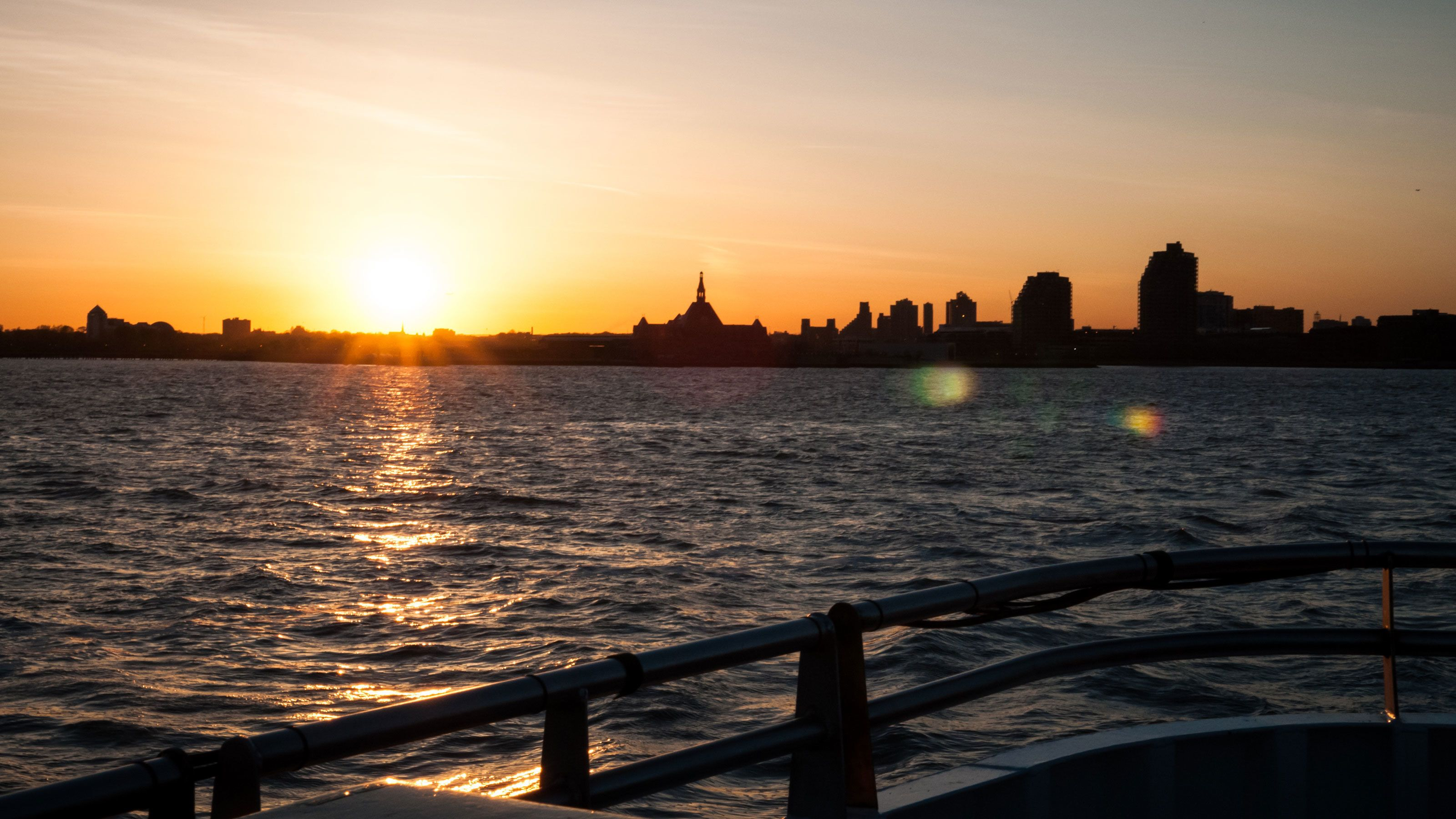 Skyline of the city at sunset from the deck of a boat in New York
