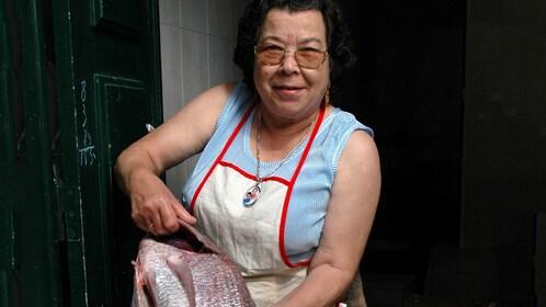 locals preparing fish in Portugal
