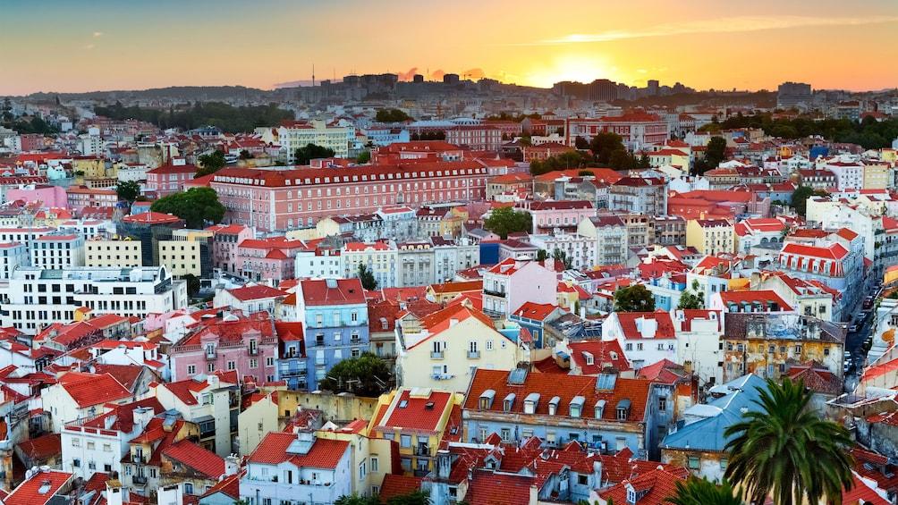 Åpne bilde 1 av 6. sun setting on the dense town of Lisbon