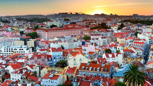 sun setting on the dense town of Lisbon