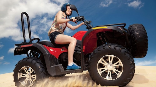 Girl on off road sport utility in soft sand on the Tangalooma Dolphin Adventure Day Trip