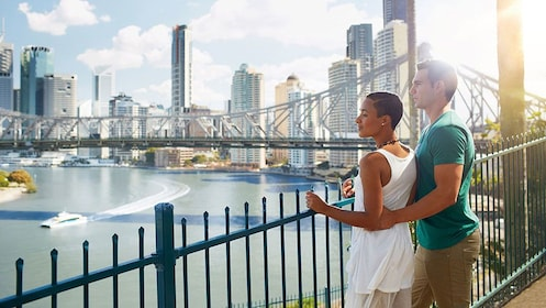 Couple over looking the water in the city on the Brisbane Best City Sights Tour in Australia