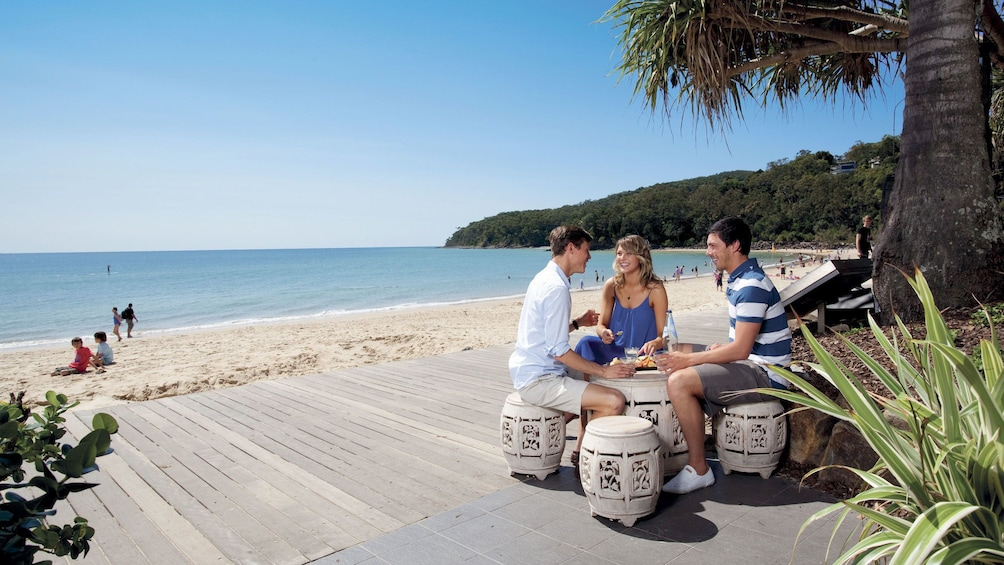 Show item 1 of 7. People sitting on a patio beach side in Australia