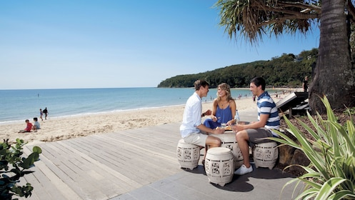 People sitting on a patio beach side in Australia