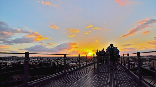 group of people standing on Story Bridge at sunset in Brisbane