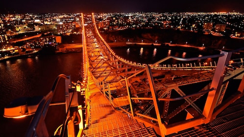 Story bridge lit up at night in Brisbane