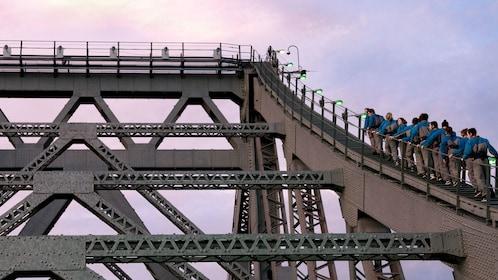 Tour group climbing side of bridge in Brisbane