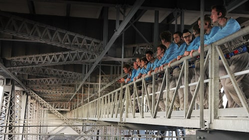Group looking out from underneath bridge in Brisbane
