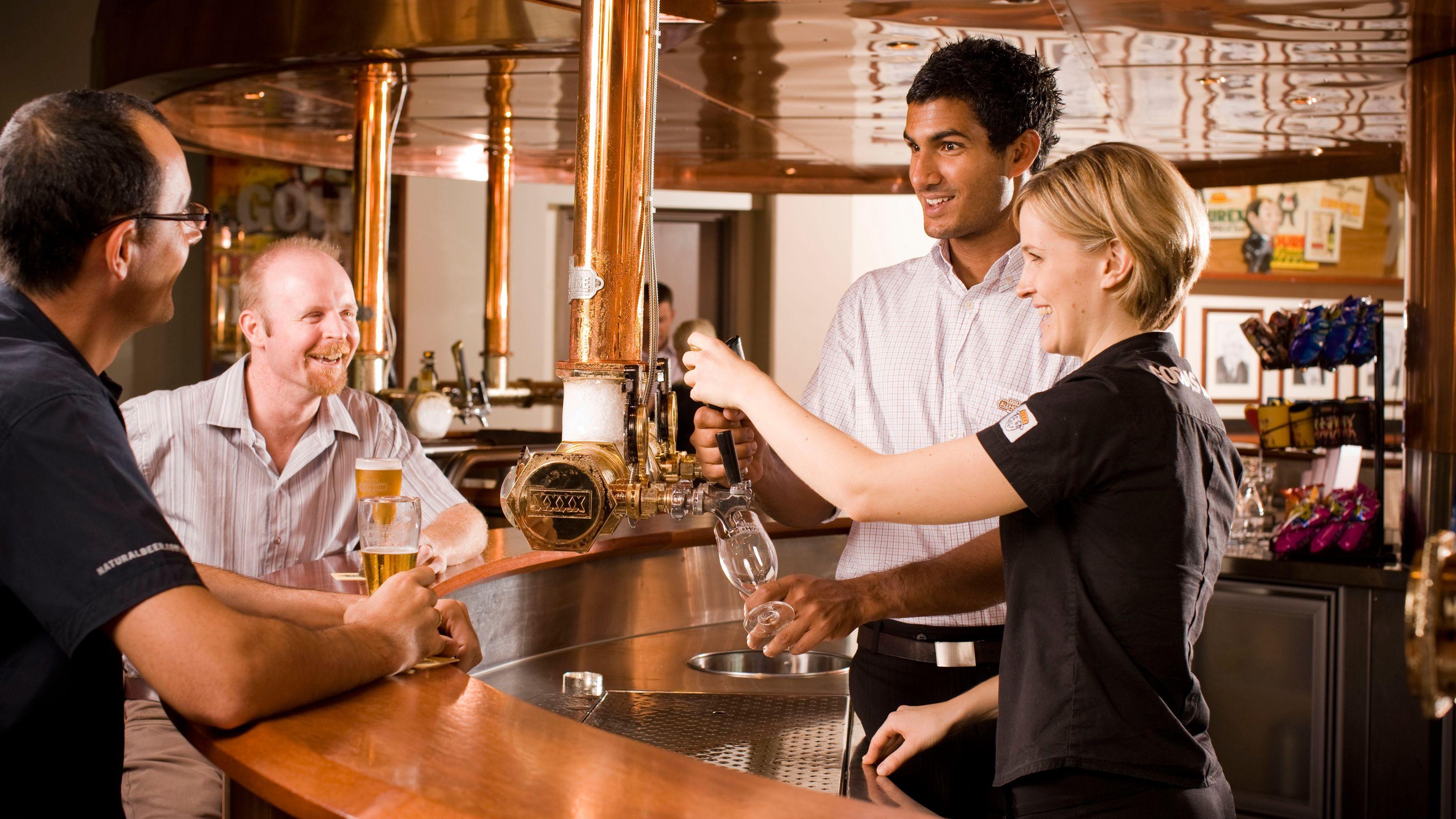 Taste testing on the Brisbane XXXX Brewery Tour in Australia