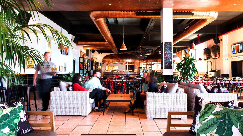 Group enjoying time at XXXX Brewery restaurant in Brisbane