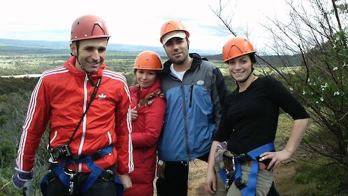 Group of four happy climbers in safety gear in Melbourne