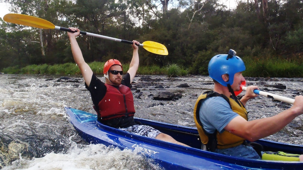 Show item 3 of 5. two men in Kayak paddle through rapids in Melbourne