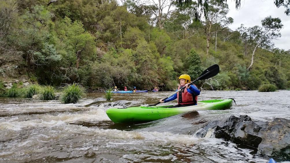 Show item 1 of 5. man in kayak paddles through river rapids in Melbourne