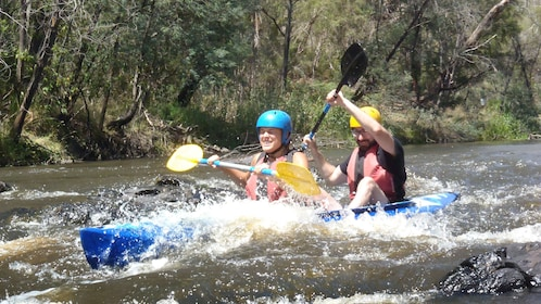 couple paddle through river rapids in Melbourne