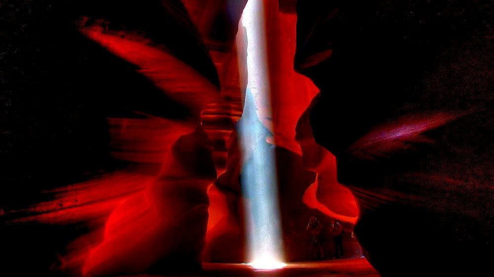 Sun peeks through the ceiling of the slot canyons of Antelope Canyon