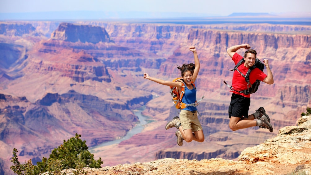 Show item 1 of 5. Couple celebrate their arrival to the Grand Canyon