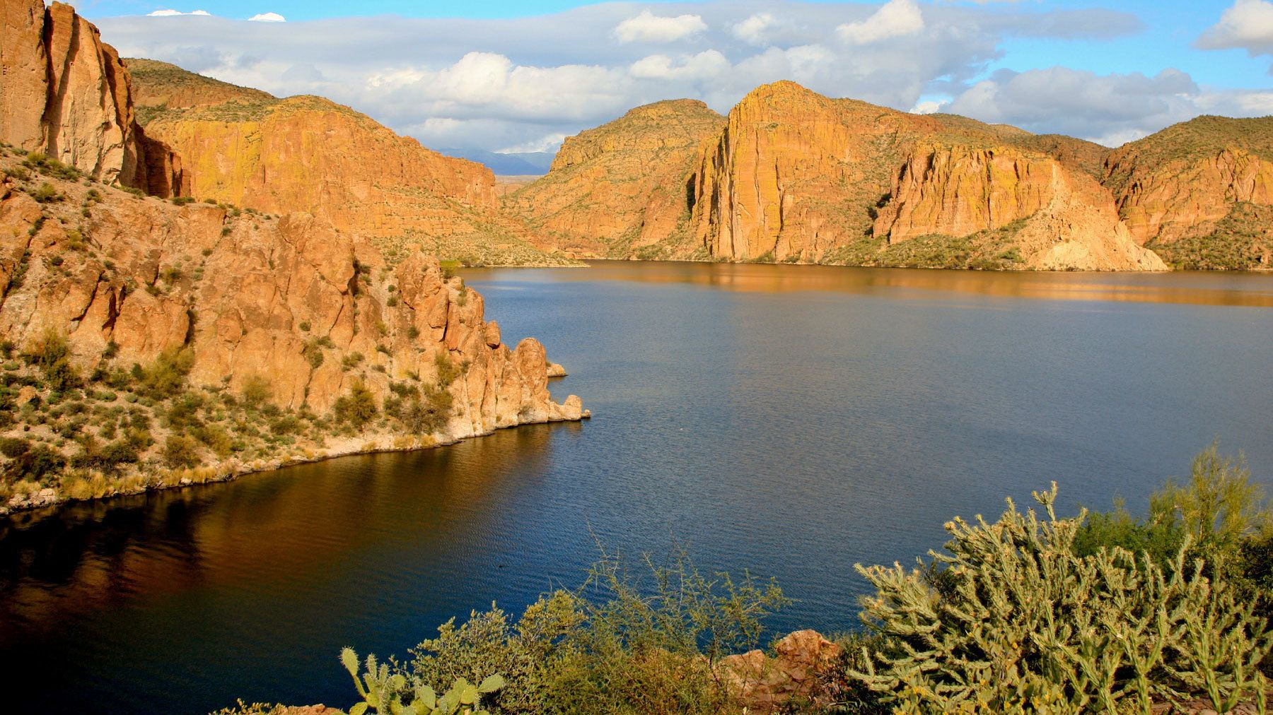 Cliffs and rock formations surround Canyon Lake near Apache Junction in Arizona