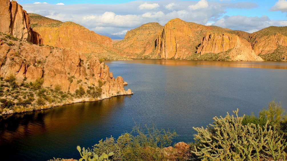 Show item 5 of 5. Cliffs and rock formations surround Canyon Lake near Apache Junction in Arizona