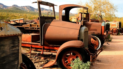 Vintage rusted out trucks and tractors in a ghost town in Arizona
