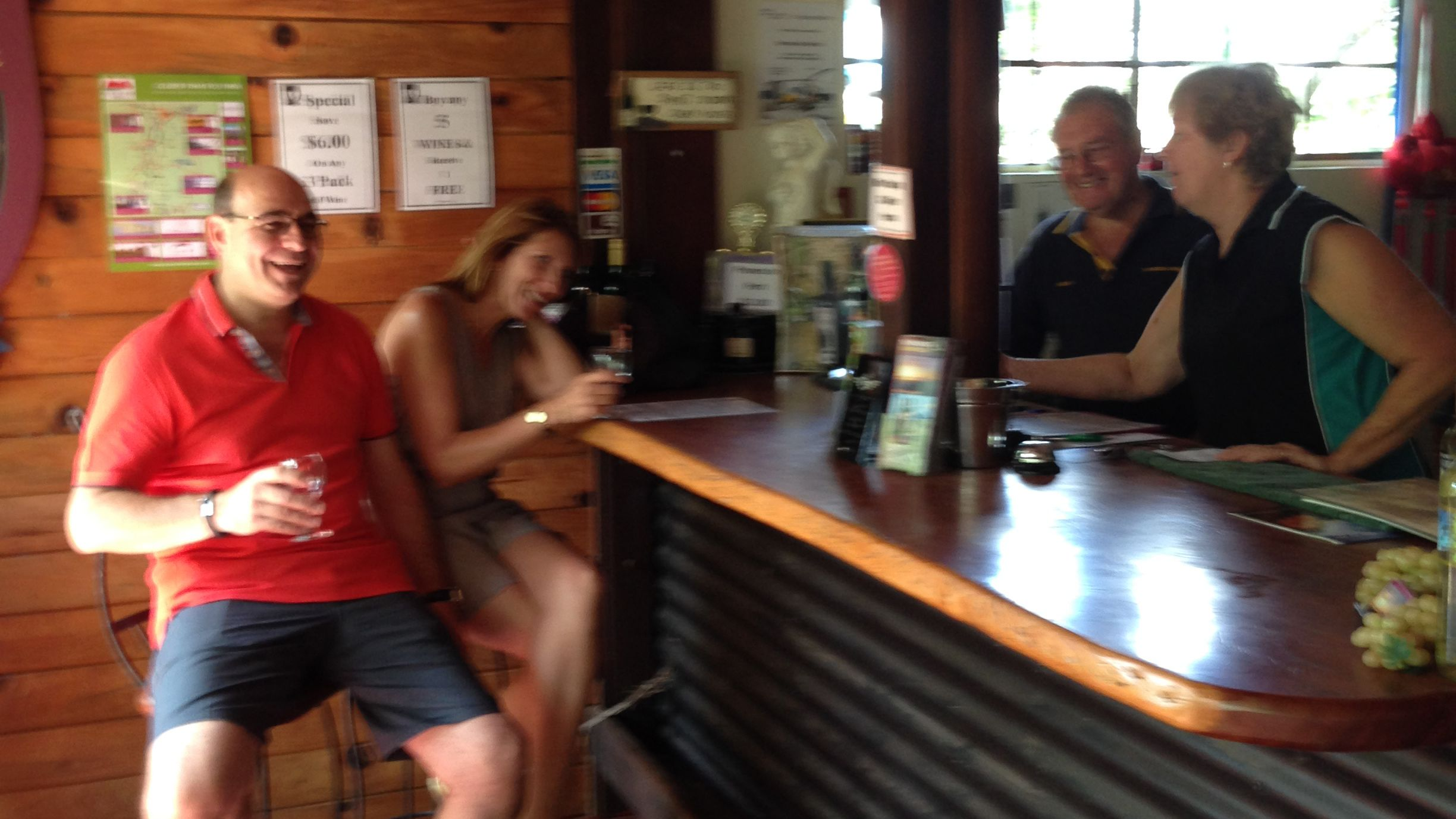 a couple enjoy glass of wine at winery in Gold Coast