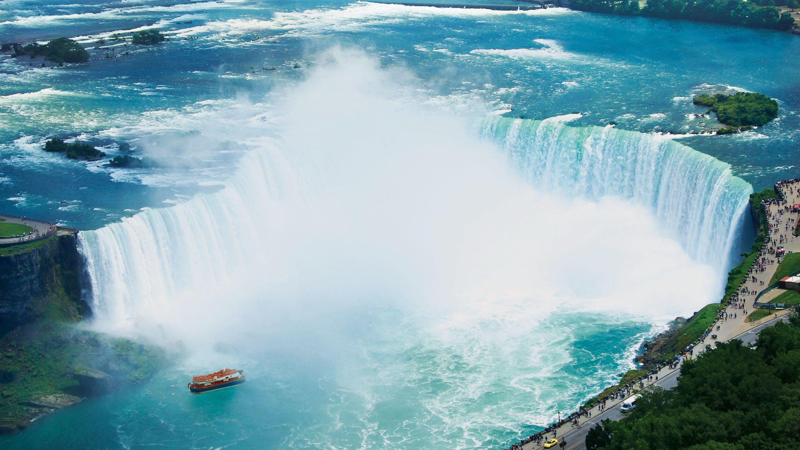 Boat going along the waterfall in Niagara Falls