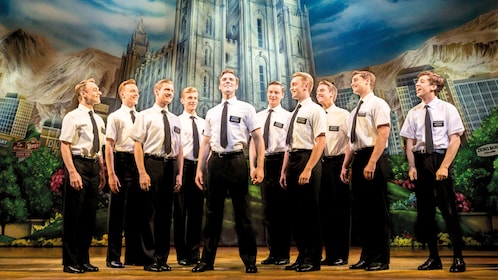 10 men singing in play on stage in The Book Of Mormon in London
