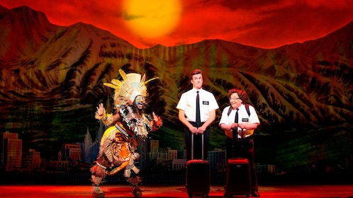 three actors on stage in play of The Book Of Mormon in London
