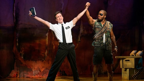 two actors dancing on stage in The Book Of Mormon in London