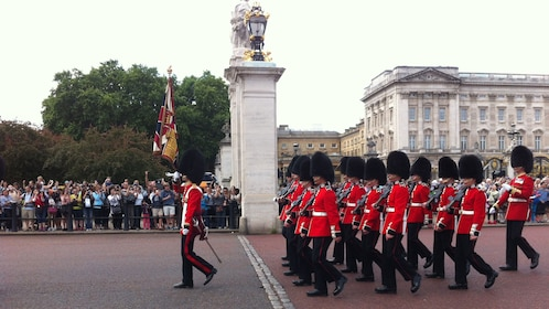 Royal Palace guards marching in formation at Buckingham Palace in London