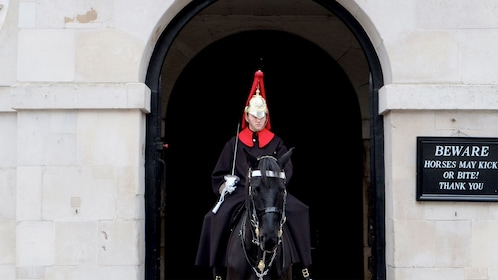 London soldier riding black horse in London