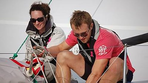 man and woman work rigging aboard yacht in Sydney