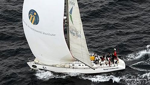 white yacht sailing on waves in Sydney