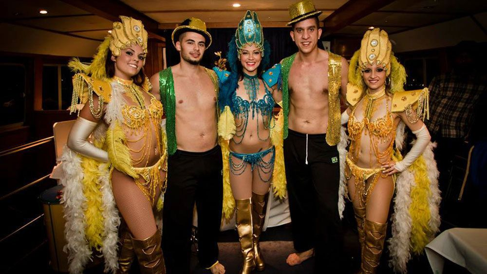 Performers in costumes for the Harbour Dinner Cruise with Latino Show in Sydney