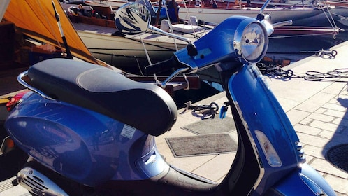 Close view of a blue Vespa in Cannes