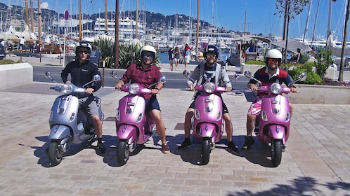 Group enjoying tour of Cannes on Vespas
