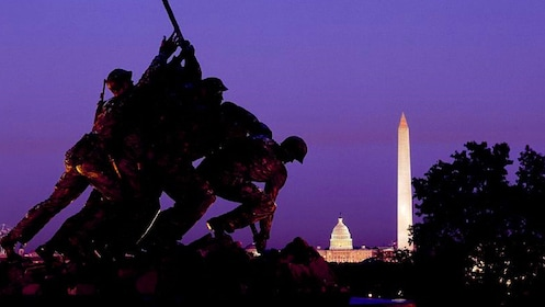Statue to Iwo Jima next to a small Capital building and Washington Monument