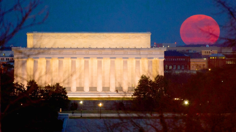 Show item 3 of 7. A blood moon next to the Lincoln monument