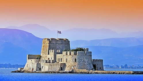 The Castle of Bourzi surrounded by water in the Nafplio Harbor in Greece