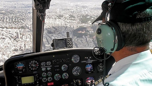 Helicopter pilot and view of the city below in Athens