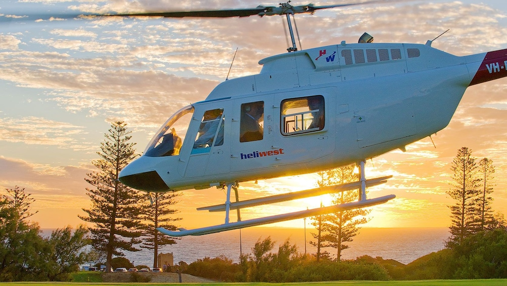 Show item 1 of 4. Helicopter taking off on the Fremantle Flyer Scenic Flight in Perth