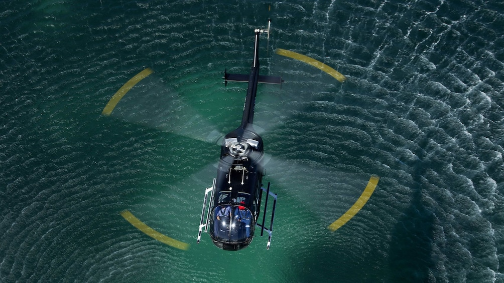 Show item 2 of 4. Helicopter over water in Fremantle Flyer Scenic Flight in Perth